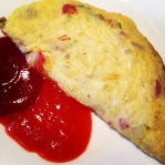 The sweet and chili sauce is a perfect condiment for the omelet.
